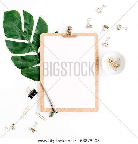 Home office workspace mockup with clipboard palm leaf and clips. Flat lay top view