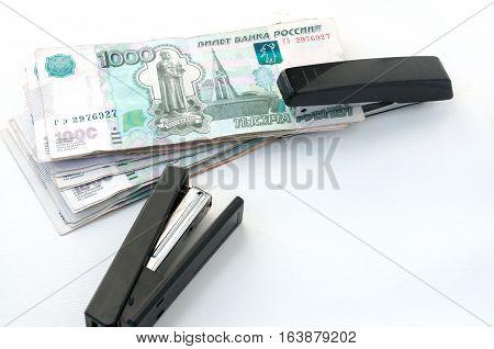 Two Stapler And Money. Ruble Strengthening Concept  Два степлера и деньги. Концепция укрепления рубл