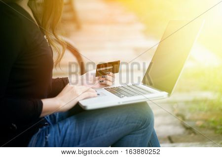 Young Asian Woman Paying Online Product By Credit Card For Shopping At Home In Holiday Time, Vintage