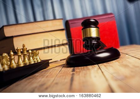 Judge Gavel On Old Weathered Wood Table With Vintage Book And Chess Checkers, Closeup Shot Of Photog