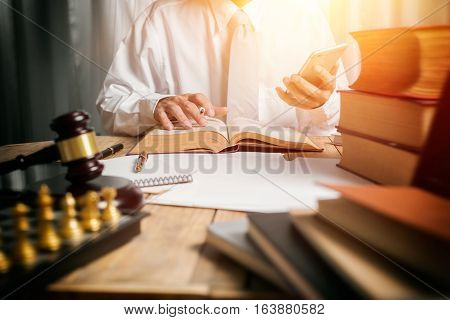 Young Man Lawyer Give Suggestion Mobile Customer And Reading The Lawyer Book For Legislation Issue T
