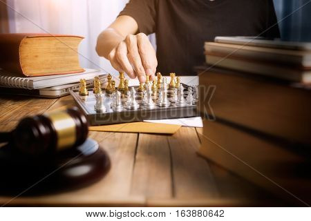 Working Desk Of Lawyer, Business Man Lawyer Playing Golden Chess On His Desk, Battle And Justice Con