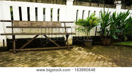 An empty bench made from wood at Lawang Sewu photo taken in Semarang Indonesia java
