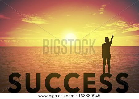 Silhouette young woman standing and raising up her hand about fighting concept on success text over a beautiful sunset or sunrise at the sea. background for success in 2017 years .hope to success