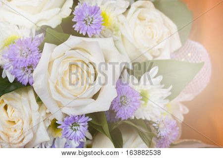 Close up bouquet of mixed flowers with sunlight effect