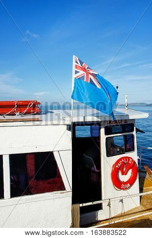 Taveuni, Fiji - November 29: National Flag Of Fiji Flying On A Small Boat Docked At Korean Wharf On