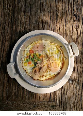 Indochina pan fried egg with pork and toppings, Breakfast food in Thai style