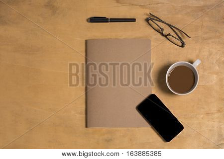Cellphone With Notebook Paper On Wood Table Desk