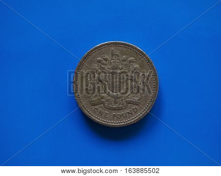 One Pound (gbp) Coin, United Kingdom (uk) Over Blue