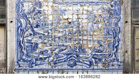 CAXIAS, PORTUGAL - October 26, 2016: Detail of the highly degraded tiles decorating the facade wall of the 18th century Royal Palace of Caxias Portugal