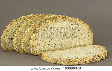 Slices of wholemeal grain bread on a brown background