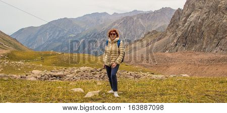 Aged Sport Woman In Sunglasses Are Standing In The Mountains, Tien Shan, Almaty, Kazakhstan