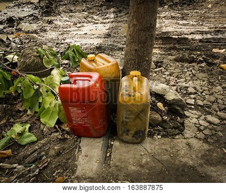 Petroleum Jerry Can abandoned in a garden photo taken in Semarang Indonesia java
