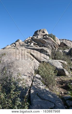 Views of La Pedriza Madrid Spain. It is a granite mountain where geological forces have create a remarkable boulder field of strangely eroded granite outcrops.