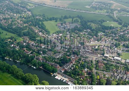 View from a plane of the village of Datchet Berkshire. The historic village lies on the banks of the River Thames near Windsor and has the M4 motorway running to the north.