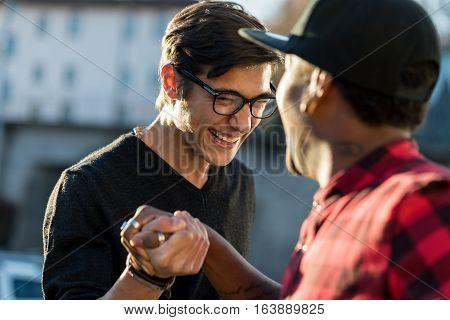 Good Friends Joking About Their Secret Handshake