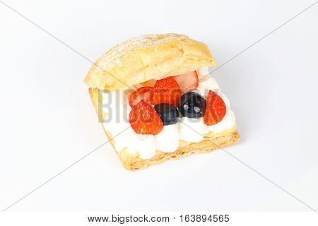 Fruity cream puff pastry on white background