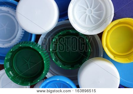 Different lids from plastic bottles.  Recycled concept.