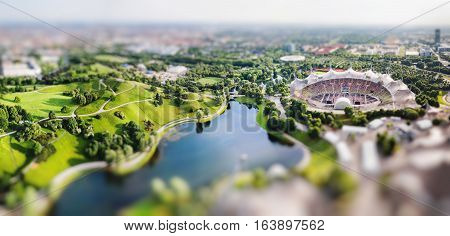 Panoramic view at Stadium of the Olympiapark in Munich Germany. Miniature tilt shift lens effect.