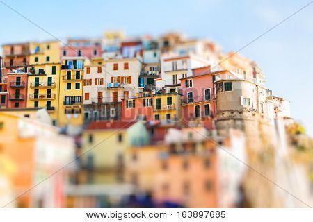 Colorful Manarola houses in Cinque Terre Italy. Miniature tilt shift lens effect.