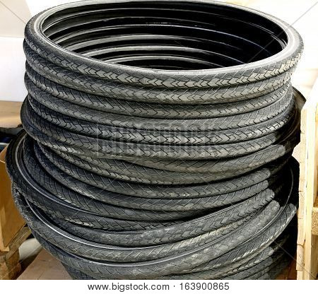Pile Of Black Used Rubber Tires For Bike