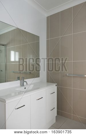 Contemporary style bathroom with vanity tiled wall