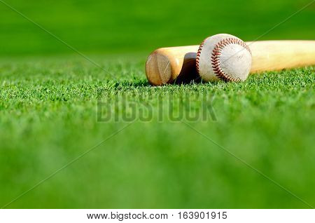 Baseball bat and ball on the field