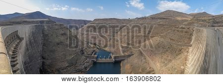 Panorama of hydroelectric Katse Dam power plant in Lesotho, Africa with view downriver.