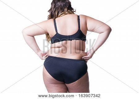 Plus size model in black lingerie overweight female body fat woman with cellulitis on buttocks posing isolated on white background back view