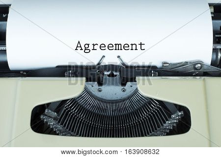 Agreement business concept text with typewriter and paper