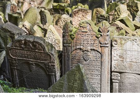 PRAGUE, CZECH REPUBLIC - APRIL 24, 2014: Tombstones on Old Jewish Cemetery in the Jewish Quarter in Prague.There are about 12000 tombstones presently visible
