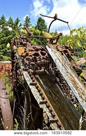 Remnants of a very old corn picker included many gears, chain, and wooden laths.