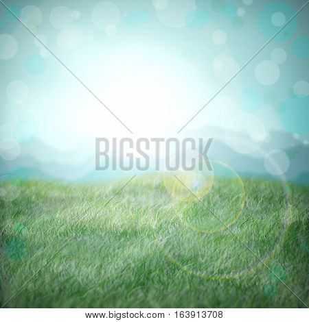 Sunbeam in a meadow in the early morning. Spring. Young grass. Spring background with bokeh.