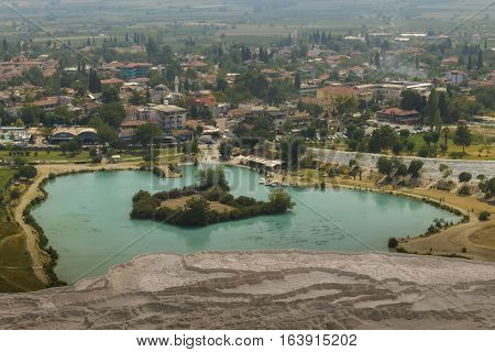 Scenic view of Pamukkale city and travertine terraces with turquoise lake Turkey.