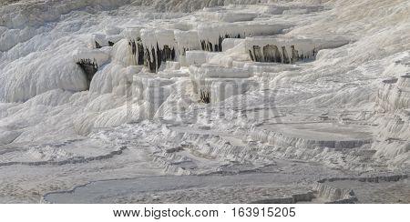 Unique white travertines terraces of Pamukkale in Denizli Province Turkey.