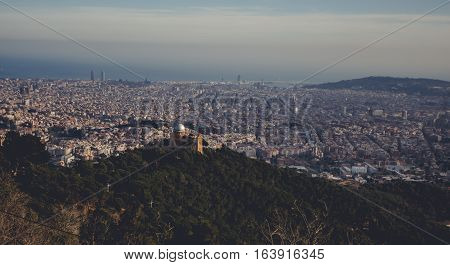 Panoramic mountain landscape in a city Barcelona. Europa, Barcelona, Spain. Old Building in Barcelona, Spain. Top view of the city. Barselona panorama