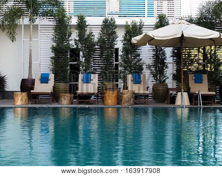 COLOR PHOTO OF INDOOR SWIMMING POOL DECKCHAIRS