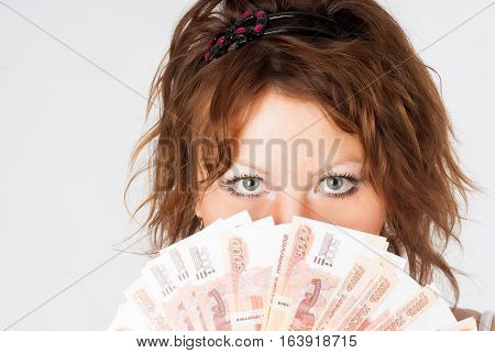 Portrait of beautiful woman in white with roubles