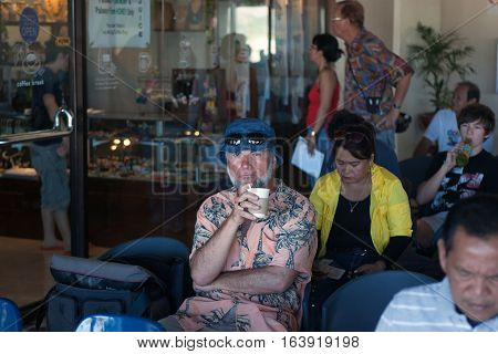 Busuanga Philippines - JANUARY 18 2012: People sit at the waiting hall at the airport of Busuanga