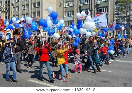 People with balloons and flags participate in demonstration in honor of a Victory Day on May 9 2016. Tyumen Russia.