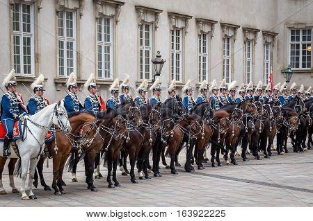 Copenhagen Denmark - January 04 2017: The Guard Hussar Regiment awaiting Queen Margrethe in her 24-carat golden coach at Christiansborg Palace