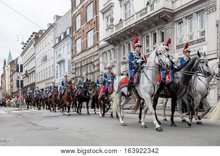 Copenhagen Denmark - January 04 2017: The Guard Hussar Regiment escorting Queen Margrethe in a 24-carat golden coach from Christiansborg Palace to Amalienborg Palace