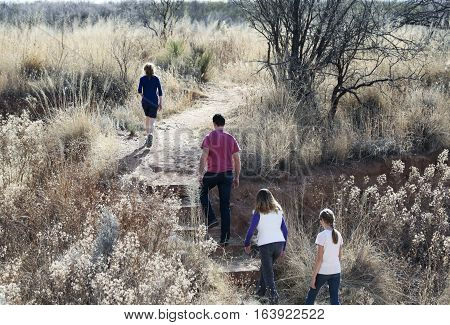 SIERRA VISTA, ARIZONA, DECEMBER 20. The Murray Springs Clovis Site on December 20, 2016, east of Sierra Vista, Arizona. A family hikes at the Murray Springs Clovis Paleoindian Site where ancient humans and woolly mammoths have been discovered.