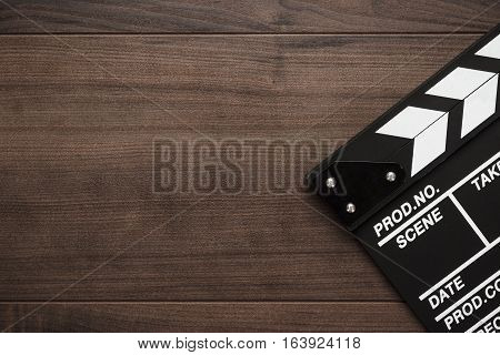 vintage classic clapperboard on brown wooden table