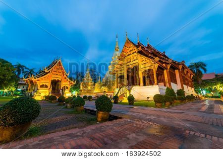 Wat Phra Singh temple at twilight or dawn. This temple contains supreme examples of Lanna art in the old city center of Chiang MaiThailand.