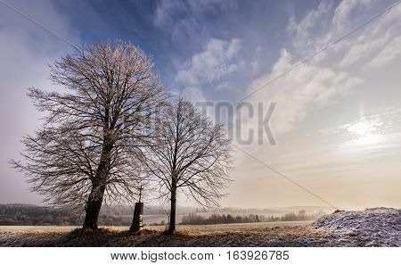 Winter landscape lit by the sun and trees. Moravian landscape Rajec Jestrebi.