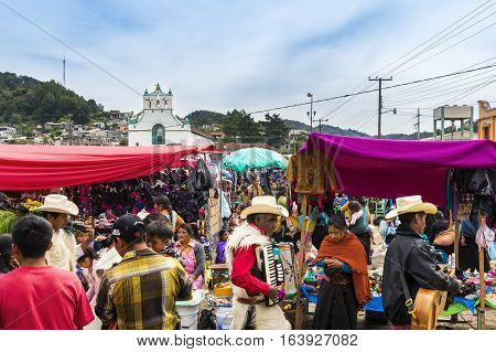 San Juan Chamula Mexico - May 11 2014: Local people in a street market in the town of San Juan Chamula Chiapas Mexico