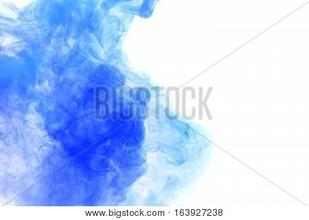 Abstract smoke Weipa. Personal vaporizers fragrant steam. The concept of alternative non-nicotine smoking. Blue vape smoke on a white background. E-cigarette. Evaporator. Taking Close-up. Vaping.
