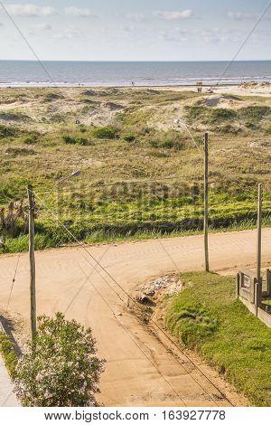 Village Dirty Street, Dunes, Vegetation And Beach At Cassino Beach
