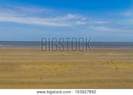 Clouds, Sand And Waves In Cassino Beach